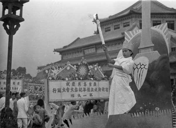 """Unnamed boy is dressed as the """"angel of peace"""" (heping tianshi)"""