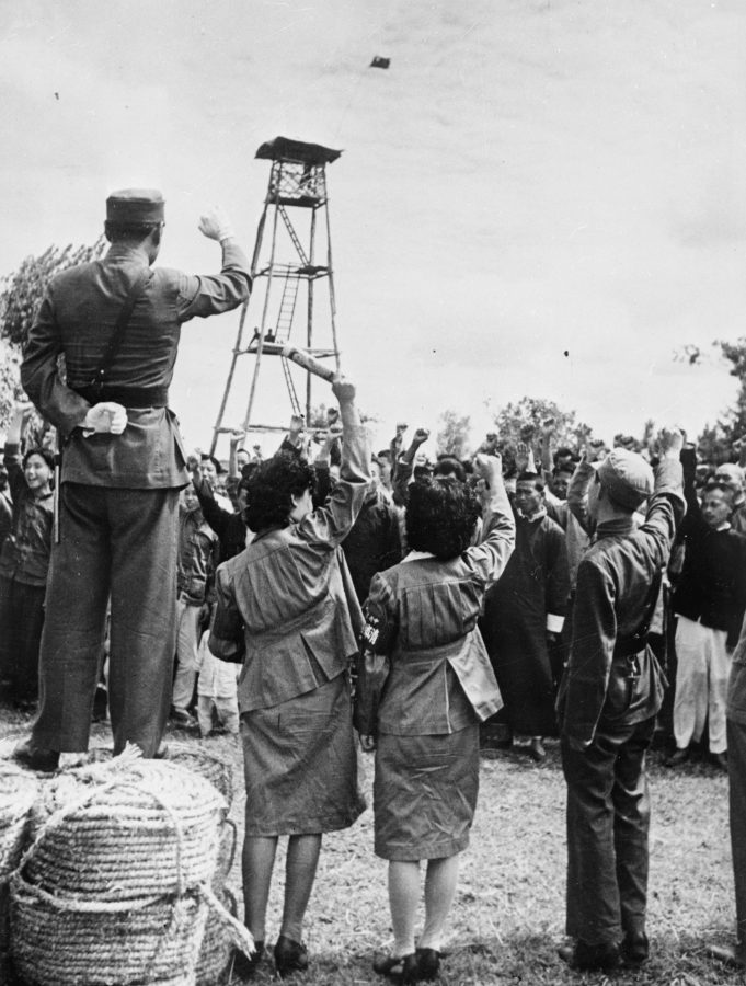 Propaganda cadres lead rural residents at a Rural Pacification event somewhere in Japanese-occupied China, circa 1942