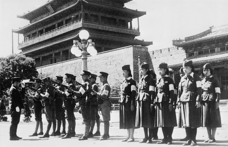 Male and female army recruits at drill training in Japanese-occupied Beijing, c. 1942.