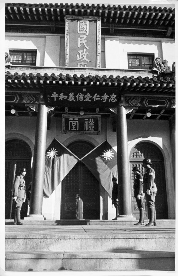 Chinese and Japanese soldiers guarding the entrance to the ceremonial hall (litang) of the national government compound in Nanjing, 1940