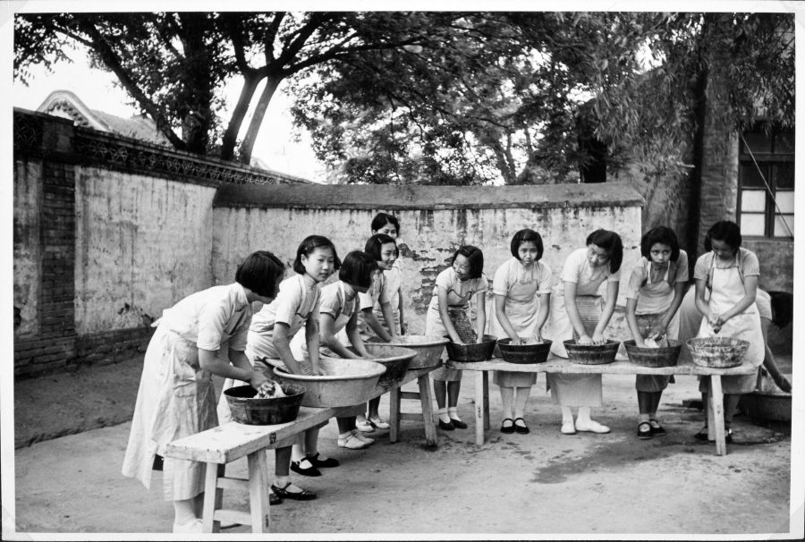Students at the Peking Jiyu Gakuen School hand-washing laundry.