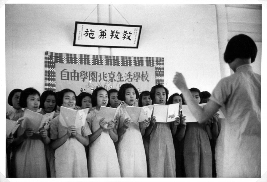Students at the Peking Jiyu Gakuen School singing in a school choir.